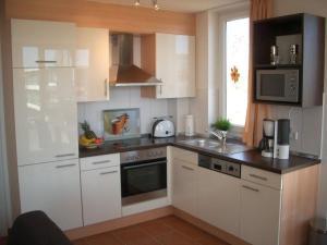 Kuchyň nebo kuchyňský kout v ubytování Ferienwohnung Windrose 7