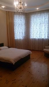 Cama ou camas em um quarto em Baku Butik Mini-Hotel