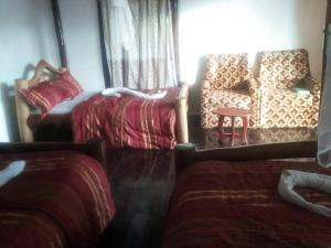 A bed or beds in a room at Ruhija Community Rest Camp