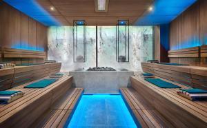 The swimming pool at or near Quellenhof Luxury Resort Lazise