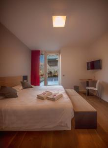 Letto o letti in una camera di La Villa - Luxury Guest House