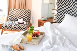 A bed or beds in a room at Gecko Hotel & Beach Club