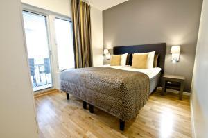Säng eller sängar i ett rum på Holiday Club Åre Apartments