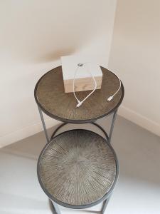 Ein Sitzbereich in der Unterkunft Hôtel Au Bon Coin