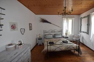 Letto o letti in una camera di Casa Angiolina - Holidays - Appartamento Dolce Letargo