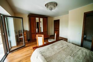 Cama o camas de una habitación en Ezera Park Hotel