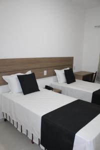 A bed or beds in a room at Hotel Irmãos Vaz Br 116 - Entronc. De Jaguaquara