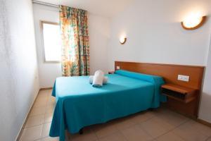 Cama o camas de una habitación en Almonsa Playa
