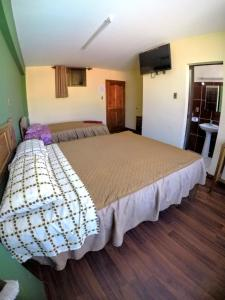 A bed or beds in a room at Residencial Uruguay