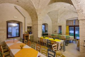 A restaurant or other place to eat at Masseria Ferri