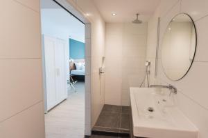 Ванная комната в Van der Valk Hotel Melle - Osnabrück