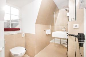 Ein Badezimmer in der Unterkunft Hotel Einhorn