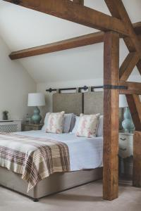 A bed or beds in a room at The Clive Arms