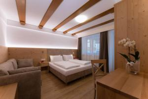 A bed or beds in a room at Villa Caterina