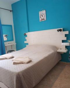 Ένα ή περισσότερα κρεβάτια σε δωμάτιο στο Sokaki rooms