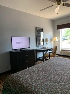 A television and/or entertainment center at Days Inn by Wyndham Glen Allen