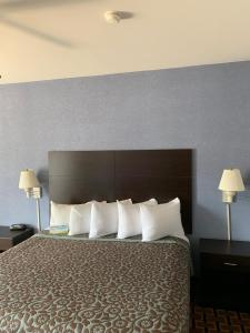 A bed or beds in a room at Days Inn by Wyndham Glen Allen