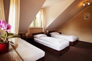 Łóżko lub łóżka w pokoju w obiekcie Pensjonat Bartosz