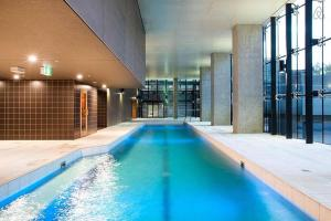 The swimming pool at or near A Cozy Suite with a View of Docklands & The Yarra