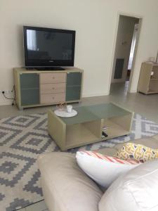 A television and/or entertainment center at Mint Accommodation - William & Solomon