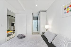 A bed or beds in a room at Agora on Lonsdale in Melbourne CBD