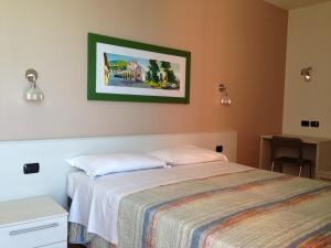 Ein Bett oder Betten in einem Zimmer der Unterkunft Residence CaFelicita
