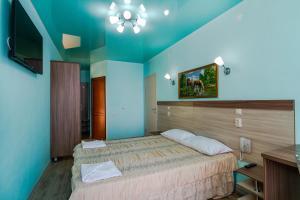 Кровать или кровати в номере Гостевой Дом Иван да Марья