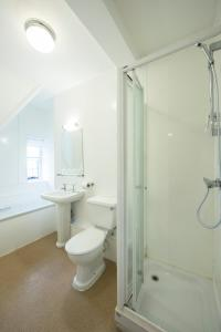 A bathroom at Half Moon, Sherborne by Marston's Inns