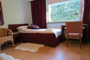 Vuode tai vuoteita majoituspaikassa Laatokan Portti Apartments