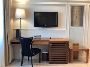 A television and/or entertainment center at Hotel Olid
