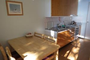 Majoituspaikan Laatokan Portti Apartments keittiö tai keittotila