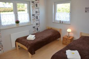 Ein Bett oder Betten in einem Zimmer der Unterkunft Gästehaus Celine