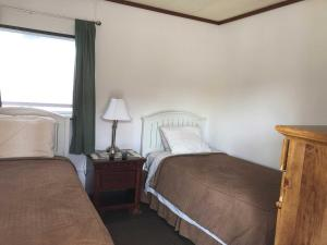 A bed or beds in a room at Uncle Nicolai's Inn