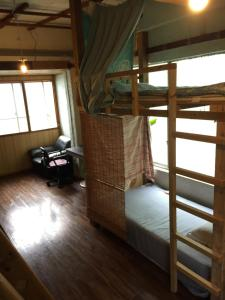 A bunk bed or bunk beds in a room at Asahi Guest House