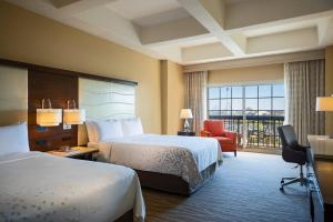 A bed or beds in a room at Renaissance Orlando at SeaWorld®