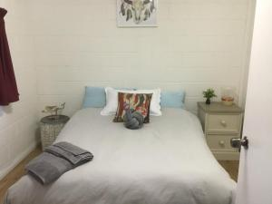 A bed or beds in a room at 35 Trevena Road