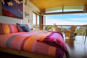 A bed or beds in a room at Hobart Hideaway Pods
