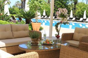 Der Swimmingpool an oder in der Nähe von Villa Augusto Boutique Hotel & SPA