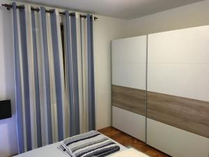 A bed or beds in a room at Nela Apartment