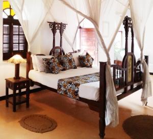Letto o letti in una camera di The Swahili House