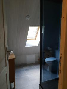 A bathroom at Bed In Bellongue