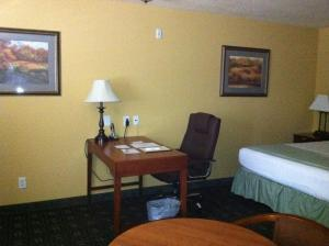 A bed or beds in a room at Southern Inn and Suites Yorktown