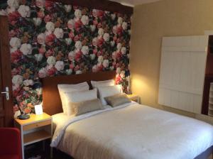 Een bed of bedden in een kamer bij B&B Aire les Biefs