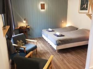 Letto o letti in una camera di Hôtel Le Cassini