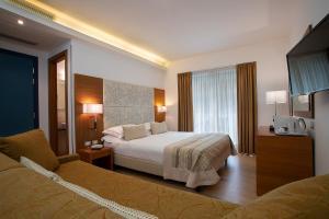 Letto o letti in una camera di Hotel Daniele