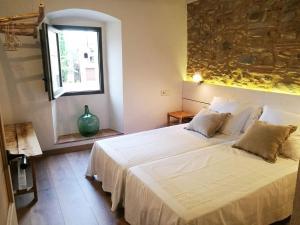 Llit o llits en una habitació de Can Puig de la Pera