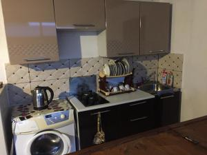 A kitchen or kitchenette at Guest House Green Island