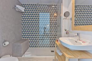 A bathroom at Hotel Pineda Splash