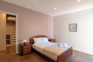 Uma cama ou camas num quarto em Porto Gaia City House by MP
