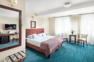 Łóżko lub łóżka w pokoju w obiekcie Hotel Bonum Old Town
